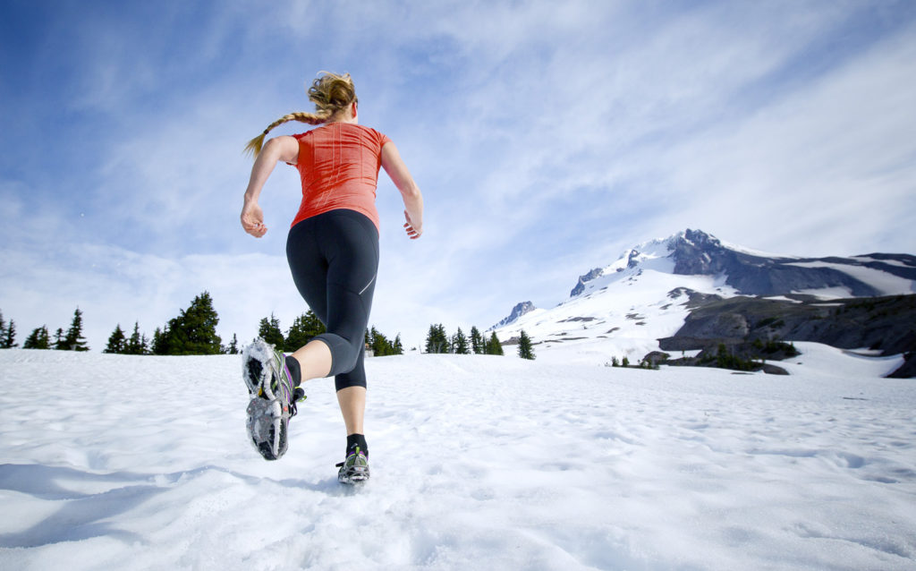 Woman Running in Snow and Ice With Yaktrax Product