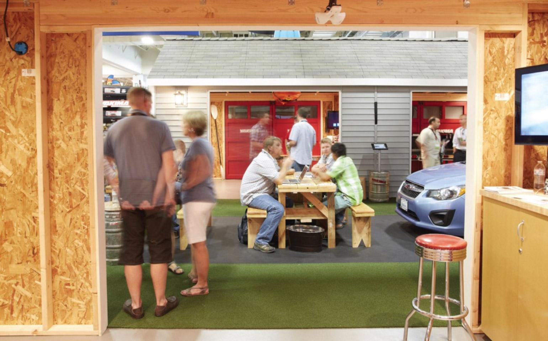 people at picnic table at tradeshow