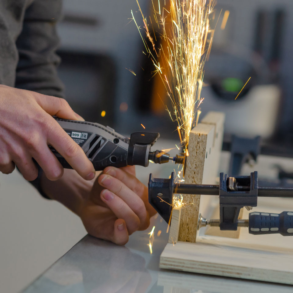 Sparks fly as metal is cut from a prototype