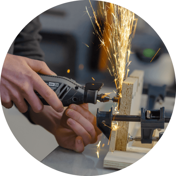Sparks fly while cutting metal with a rotary tool