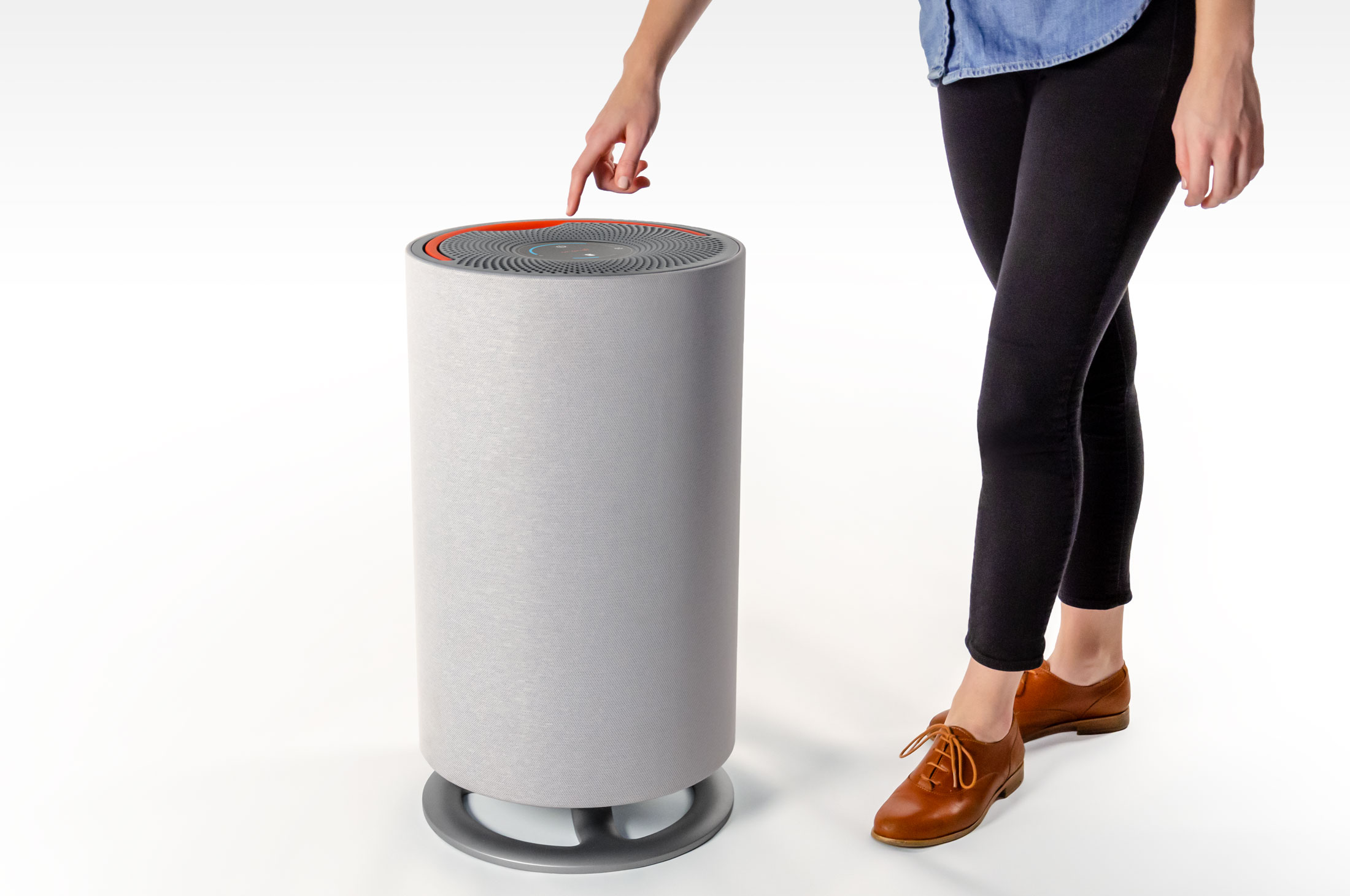 Oransi mod air purifier with person pressing controls